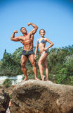 Teacher on fitness with the pupil on a beach. Athlete teacher on fitness with the pupil on a beach Royalty Free Stock Photos