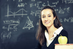 Teacher in front of a blackboard Royalty Free Stock Photo
