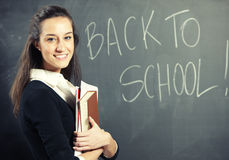 Teacher in front of a blackboard Stock Photography