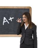 Teacher in front of blackboard Royalty Free Stock Photo
