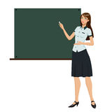 Teacher in front of chalkboard Stock Image