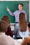 Teacher in front of a chalkboard Royalty Free Stock Image