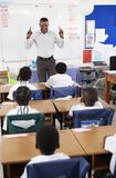 Teacher in front of classroom of elementary school kids Royalty Free Stock Photo