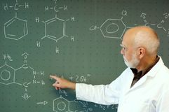 Teacher in front of his class at the blackboard Stock Photos