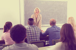 Teacher in front of students Royalty Free Stock Images
