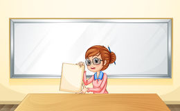 A teacher in front of the whiteboard holding an empty template Stock Image