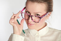 Teacher in funny eyeglasses Royalty Free Stock Image