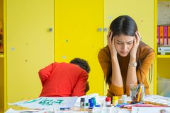 Teacher get headache with two naughty kids in classroom at kinde. Rgarten school Royalty Free Stock Images