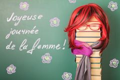 Teacher girl and Congratulations in French with the International Women`s Day. Unusual Teacher girl and Congratulations in French with the International Women`s royalty free stock photo