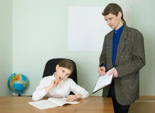 Teacher and girl with tablet Royalty Free Stock Photo