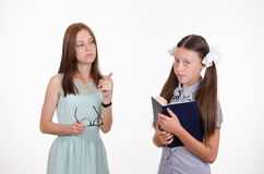 The teacher gives the student a mandate. The teacher shakes his finger and scolds student Royalty Free Stock Images