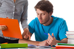 Teacher giving advice to student. Teacher giving advice about project to student royalty free stock photo