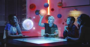 Teacher giving a class with holographic solar system