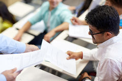 Teacher giving exam test to student man at lecture stock image