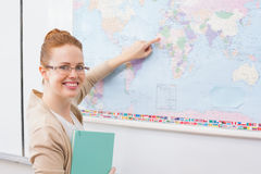 Teacher giving a geography lesson in classroom Stock Photography