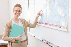 Teacher giving a geography lesson in classroom Stock Images