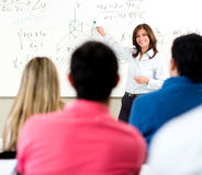 Teacher giving a lecture Stock Images