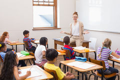 Teacher giving a lesson in classroom. At the elementary school Royalty Free Stock Photo