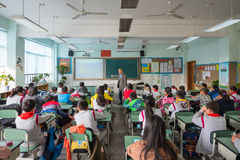 Teacher giving a lesson to children in a chinese classroom. Chengdu, Sichuan Province, China - March 31, 2017: Teacher giving a lesson to children in a chinese Royalty Free Stock Photography