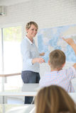 Teacher giving lessons to pupils Stock Photos