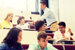 Teacher giving test to students on lecture royalty free stock image