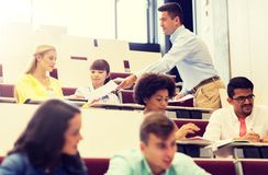 Teacher giving test to students on lecture royalty free stock photography