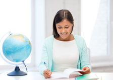 Teacher with globe and notepad at school. Education and school, travel concept - female teacher with globe and notepad Stock Images