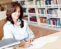 Teacher grading exams Stock Photo