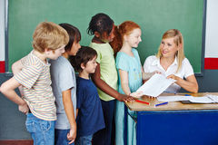 Teacher grading tests for students Royalty Free Stock Photos