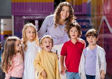 Teacher With Group Of Children In Preschool Royalty Free Stock Photography
