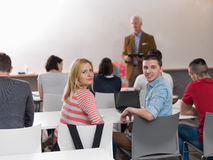 Teacher with a group of students in classroom Royalty Free Stock Photography