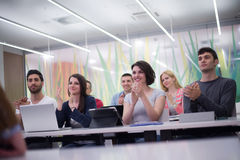 Teacher with a group of students in classroom Royalty Free Stock Photo