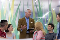 Teacher with a group of students in classroom Royalty Free Stock Images