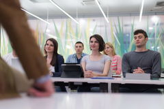 Teacher with a group of students in classroom Royalty Free Stock Photos