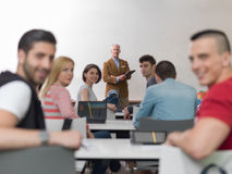Teacher with a group of students in classroom Royalty Free Stock Image