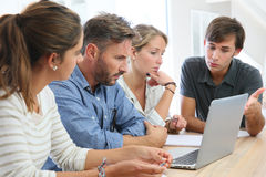 Teacher and group of students working on latop Stock Photography