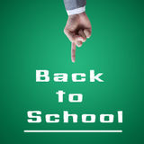 Teacher hand point to Back to school chalkboard. Stock Images