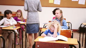 Teacher handing out papers Royalty Free Stock Photos