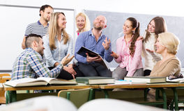 Teacher and happy adult students royalty free stock photo