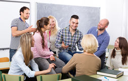 Teacher and happy adult students royalty free stock images