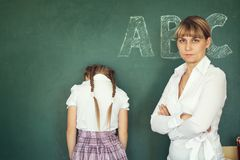 Teacher has punished the schoolgirl for the wrong example royalty free stock photos