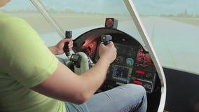 Teacher helping aviation school student control steering wheel, flight simulator. Stock footage stock footage