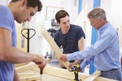 Teacher Helping College Student Studying Carpentry Royalty Free Stock Images
