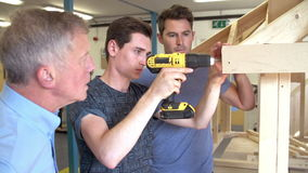 Teacher Helping College Student Studying Carpentry stock video