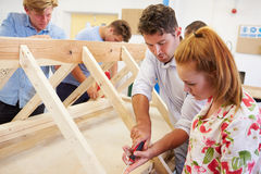 Teacher Helping College Students Studying Carpentry Royalty Free Stock Photos