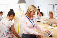 Teacher Helping College Students Studying Fashion And Design Royalty Free Stock Photo