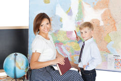 Teacher helping elementary student Stock Photo