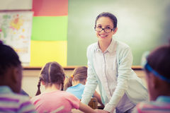 Teacher helping a pupil during class Stock Image