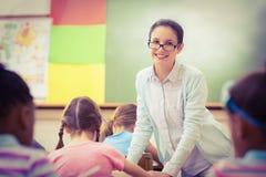 Teacher helping a pupil during class Stock Image
