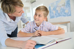 Teacher helping pupil with excercise Royalty Free Stock Photo